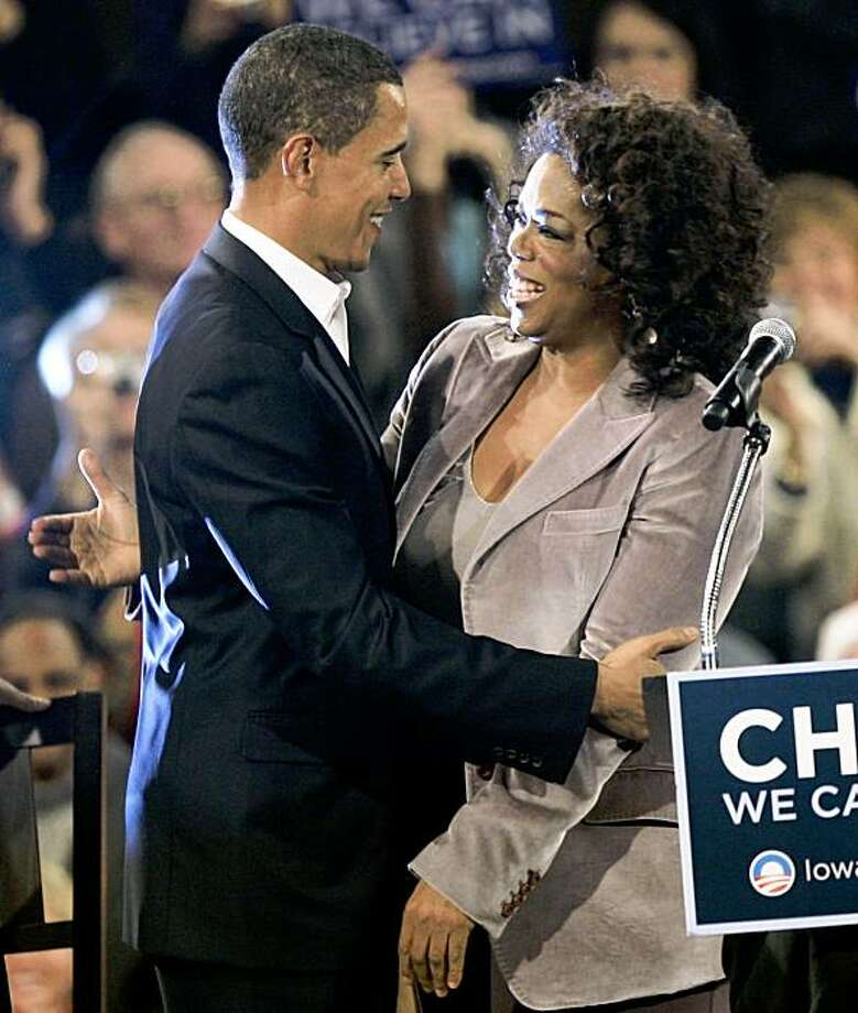 U.S. Democratic presidential candidate Senator Barack Obama (D-IL) greets entertainer and talk show host Oprah Winfrey (R) at a rally in Des Moines, December 8, 2007. Photo: JASON REED, REUTERS