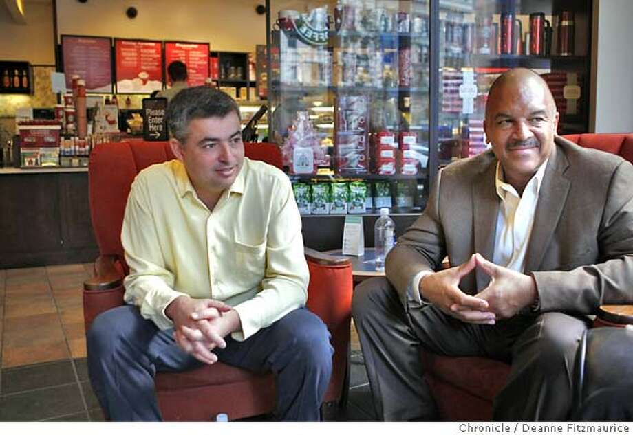 apple08_102_df.jpg  (l to r) Eddy Cue (cq) Apple's VP of iTunes and Ken Lombard, President of Starbucks Entertainment were at the 3rd Street Starbucks for the demonstrations. Apple's iTunes Wi-Fi Store will launch Thursday in Starbucks coffee shops throughout San Francisco. This partnership allows Apple customers to sync to Starbucks wireless internet network instantly from their iPods Touch, Macs and iPhones and download music. Photographed in San Francisco on 11/7/07. Deanne Fitzmaurice / The Chronicle Photo: Deanne Fitzmaurice