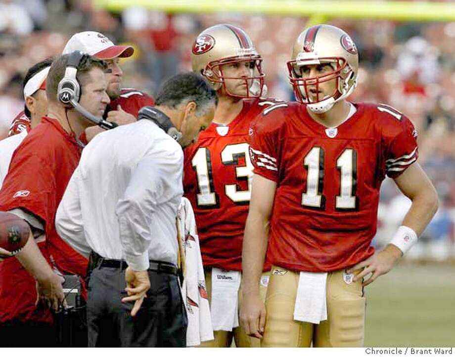 Alex Smith met with coach Mike Nolan on the sideline during the 4th quarter time out. Game action at Monster Park between San Francisco 49ers and New Orleans Saints Sunday. The Saints won 30-10. {By Brant Ward/San Francisco Chronicle}10/28/07 Photo: Brant Ward