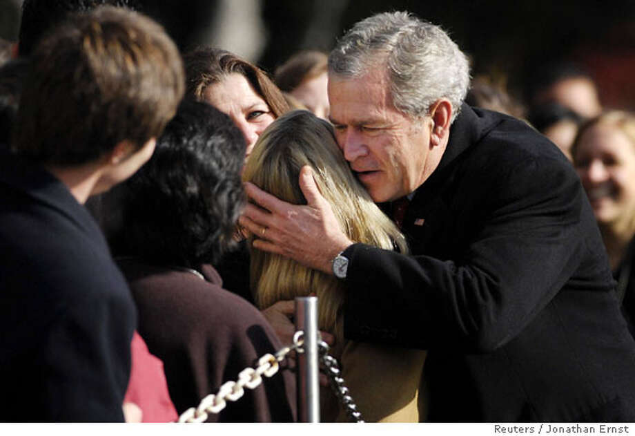 U.S. President George W. Bush gives a hug as he returns from a Thanksgiving visit at Camp David via helicopter to the White House in Washington November 24, 2007. REUTERS/Jonathan Ernst (UNITED STATES)  Ran on: 11-25-2007  President Bush returns to Washington on Saturday with a hug after a Thanksgiving visit to Camp David. He and Congress are at loggerheads on funding health care for children. Photo: JONATHAN ERNST