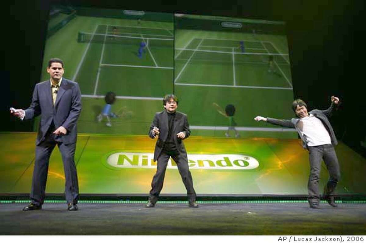 Executive Vide President of Sales & Marketing for Nintendo America, Reggie Fils-Aime, left; President of Nintendo Co., Ltd., Satoru Iwata , center, and Senior Managing Director and General Manager of the Entertainment Analysis and Development Division, Shigeru Miyamoto, right; use the new Nintendo motion sensing controller to play tennis on the new Wii gaming system during Nintendo's presentation for the 2006 E3 electronics expo in Los Angeles, Tuesday, May 9, 2006. (AP Photo/Lucas Jackson)