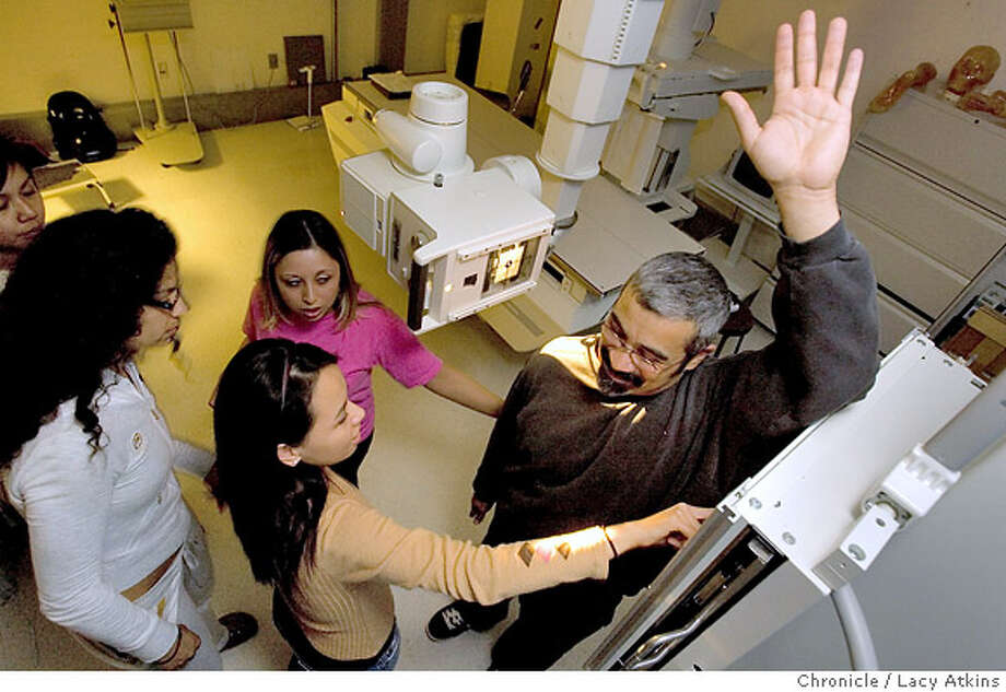 (left to right) Ana V LaFontaine, Heather Domingo and Chan Thai check the position of the X-ray on patient Daniel Chacon, during their Radiologic Technologists class at San Franicsco City College, Monday Nov. 5, 2007, in San Francisco, Ca.Students from San Francisco City College prepare for their finals by practicing their skills, Monday Nov.5, 2007, in order to be a Radiologic Technologists or Radiographers. ( THEY ARE NOT CALLED X-RAY TECHNICIANS) Photographer: Lacy Atkins /San Francisco Chronicle  Photo taken on 11/5/07, in SAN FRANCISCO , CA, USA Photo: Lacy Atkins