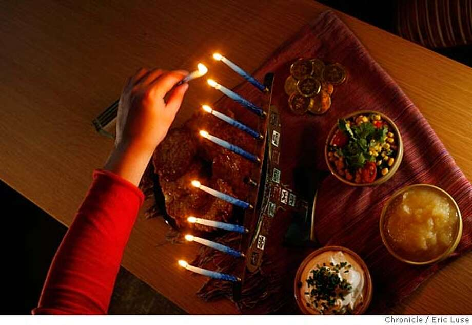 chanukahxx166_el.jpg Sarah lights her family Menorah with a Hanukkah feast of Latkes, sourcream, apple sauce and corn relish. Sarah Adler in her home wrote about how she celebrates Chanukah while reflecting on her past. Eric Luse / The Chronicle Photo taken on 11/26/07, in San Francisco, CA, USA  Names cq from source  Sarah Adler MANDATORY CREDIT FOR PHOTOG AND SAN FRANCISCO CHRONICLE/NO SALES-MAGS OUT Photo: Eric Luse