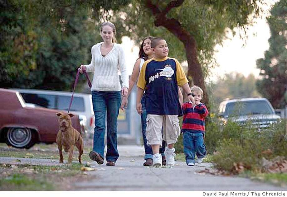 SUNNYVALE, CA - NOV 29: Meara Toussaint, 30 and her children; daugther, Desireee Pohahau, son, Malakai Pohahau, 9 and son, Isaac Sanchez, 2 at home on November 29, 2007 in Sunnyvale, California. (Photo by David Paul Morris / The Chronicle) Photo: David Paul Morris