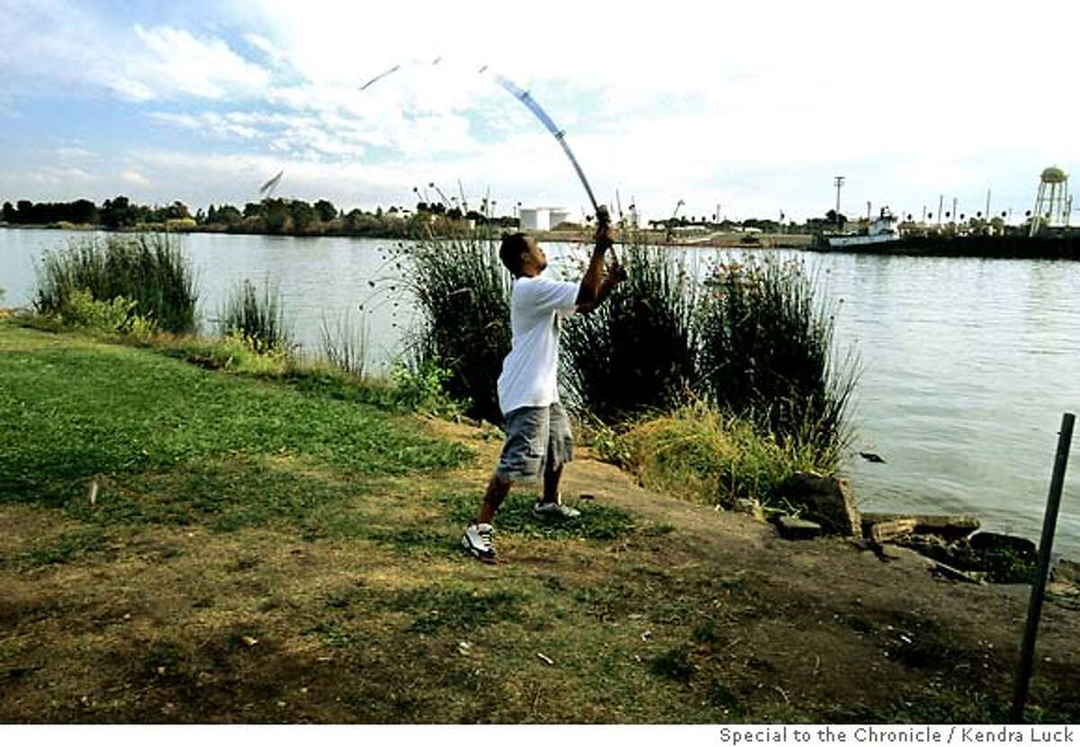 Matthew Chao, 26, fishes several times a week in the San Joaquin River at Buckley Cove, for him it is part of his culture and heritage; fishing in the Delta to a certain extent reminds him of Cambodia and the life there. Kendra Luck/The Chronicle