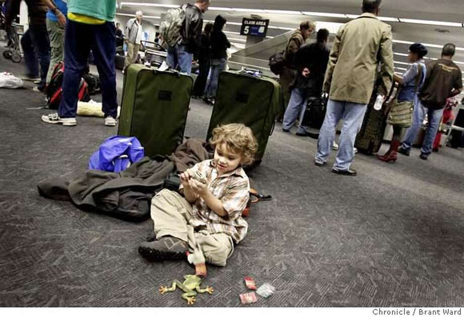 airport_747.JPG  Five year old Emmet Szewczyk played with his frogs while his parents waited for their luggage in the United terminal at SFO.  The busy holiday season at Bay Area airports has begun with Thanksgiving right around the corner and Christmas not far off. {By Brant Ward/San Francisco Chronicle}11/19/07 Photo: Brant Ward