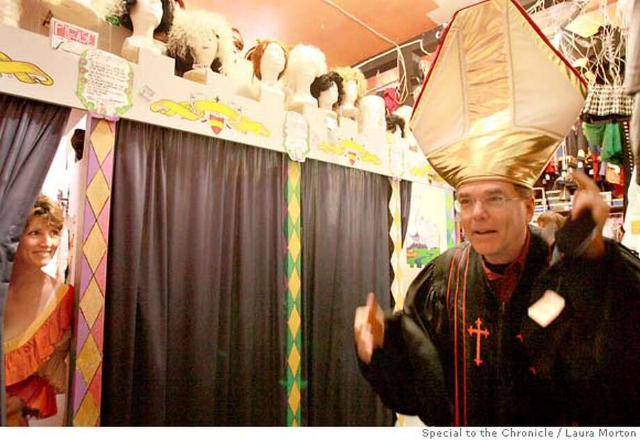 halloween30_0185_LKM.jpg Connie Freeman and Keith McKalip, who were visiting from Sumatra where they work as teachers, try on Halloween costumes at Costumes on Haight in San Francisco. (Laura Morton/Special to the Chronicle) Photo: Laura Morton