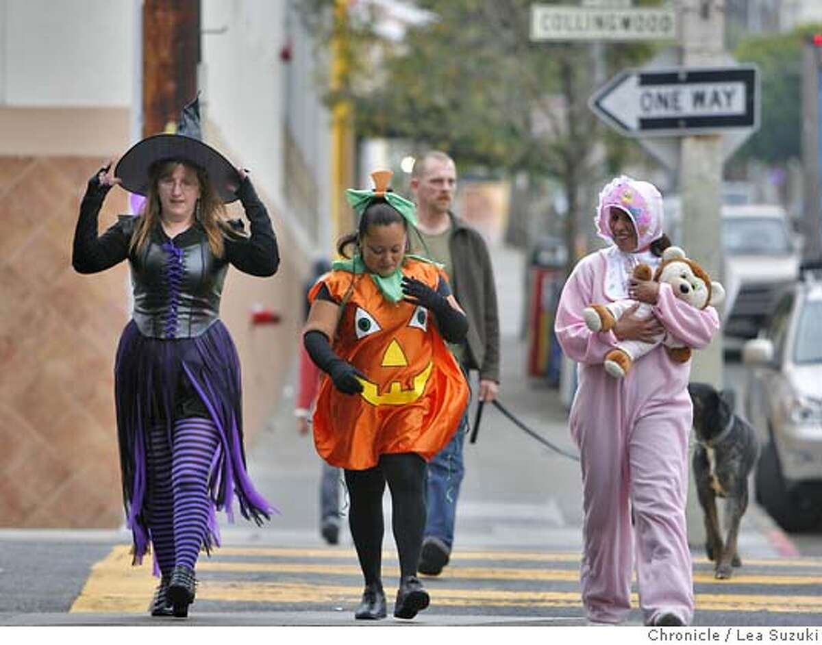 halloween_features_044_LS.jpg From left: Yvonne Biancalana, Carolina Gonzalez and Teresa Gonzalez walk in costume down 18th Street on a break from DeLano's Market where they work. They said their boss let them dress in costume for work that day. Halloween features from the Castro District. Lea Suzuki / The Chronicle Photo taken on 10/31/07, in San Francisco, CA, USA.