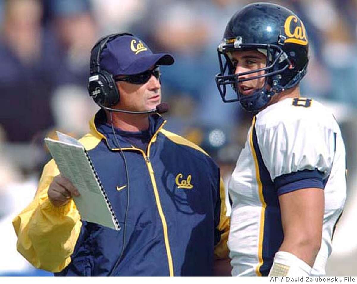 ** FILE ** California head coach Jeff Tedford confers with quarterback Aaron Rodgers during a break in the action in the first quarter of a non-conference game against Air Force in Falcon Stadium at Air Force Academy, Colo., in this Sept. 4, 2004 photo. This year, Aaron Rodgers wants to finish what he starts against USC. The Cal quarterback watched the final minutes of the Golden Bears' triple-overtime upset of the Trojans from the sideline last fall, but with a year of preparation and a growing national profile, Rodgers hopes to make his mark in the rematch. (AP Photo/David Zalubowski) Ran on: 10-08-2004 Jeff Tedford is following a familiar script leading up to the showdown with No. 1 ranked USC. Ran on: 10-08-2004 Jeff Tedford is following a familiar script leading up to the showdown with No. 1 ranked USC. A SEPT. 4, 2004 FILE PHOTO