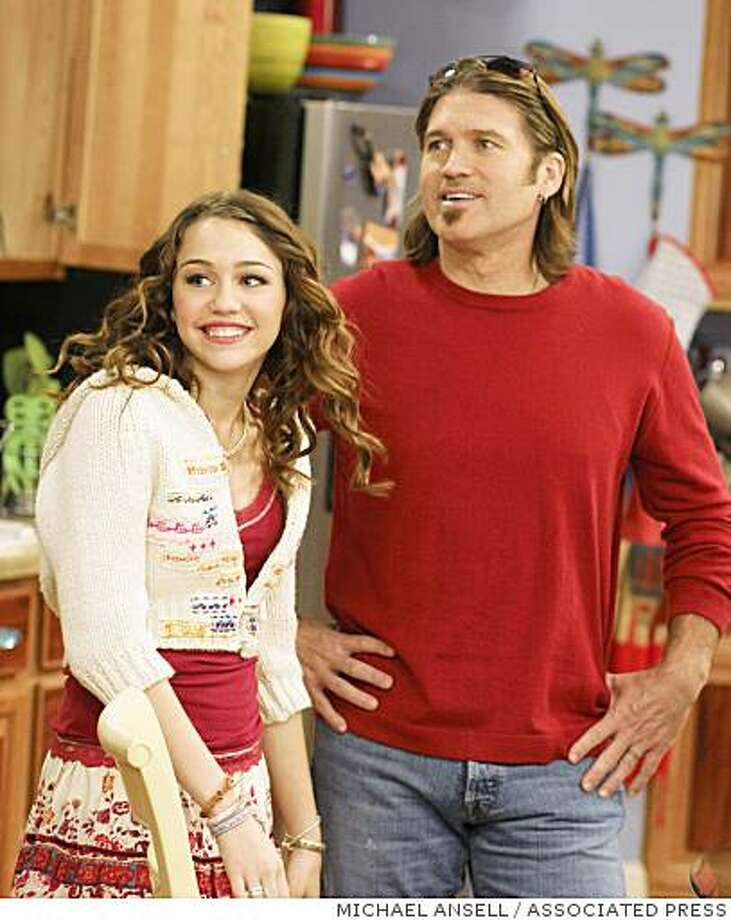 Miley and Billy Ray Cyrus in 2007 Photo: MICHAEL ANSELL, ASSOCIATED PRESS