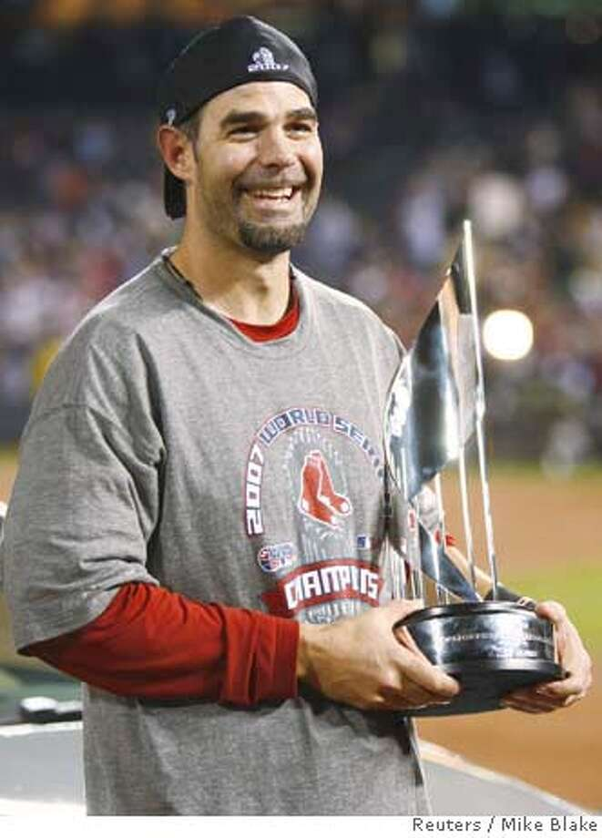 Boston Red Sox player Mike Lowell holds the MVP World Series Trophy after the Red Sox defeated the Colorado Rockies to win Major League Baseball's World Series in Denver October 28, 2007. REUTERS/Mike Blake (UNITED STATES) Photo: MIKE BLAKE