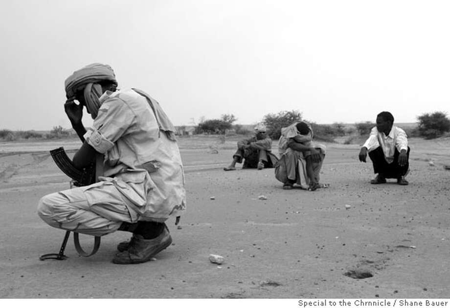 2. Rebels from the SLA-Unity faction sit stranded in the countryside. Darfur's rebel movement is now broken into at least fifteen factions. North Darfur, 2007. BY SHANE BAUER/SPECIAL TO THE CHRONICLE  Ran on: 11-25-2007  Rebels from the Sudan Liberation Army-Unity faction sit stranded in the countryside of North Darfur. The Darfur rebel movement is now broken up into at least 15 separate factions. Photo: Shane Bauer