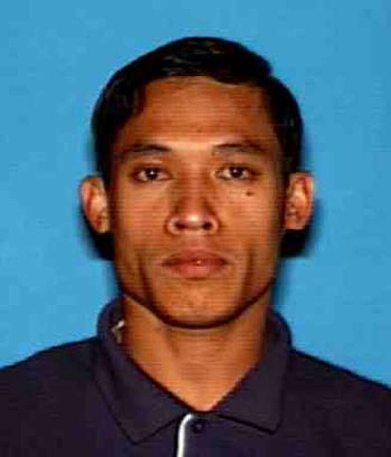 pizzaslay28_ph.JPG Undated handout picture of Thanh Thach, 38, a father of two who lived in Richmond with his wife, was shot about 9 p.m. Monday as he was trying to deliver a Pizza Hut pie on South 45th Street, authorities said. Richmond Police Department / MANDATORY CREDIT FOR PHOTOG AND SAN FRANCISCO CHRONICLE/NO SALES-MAGS OUT Photo: Richmond Police Department