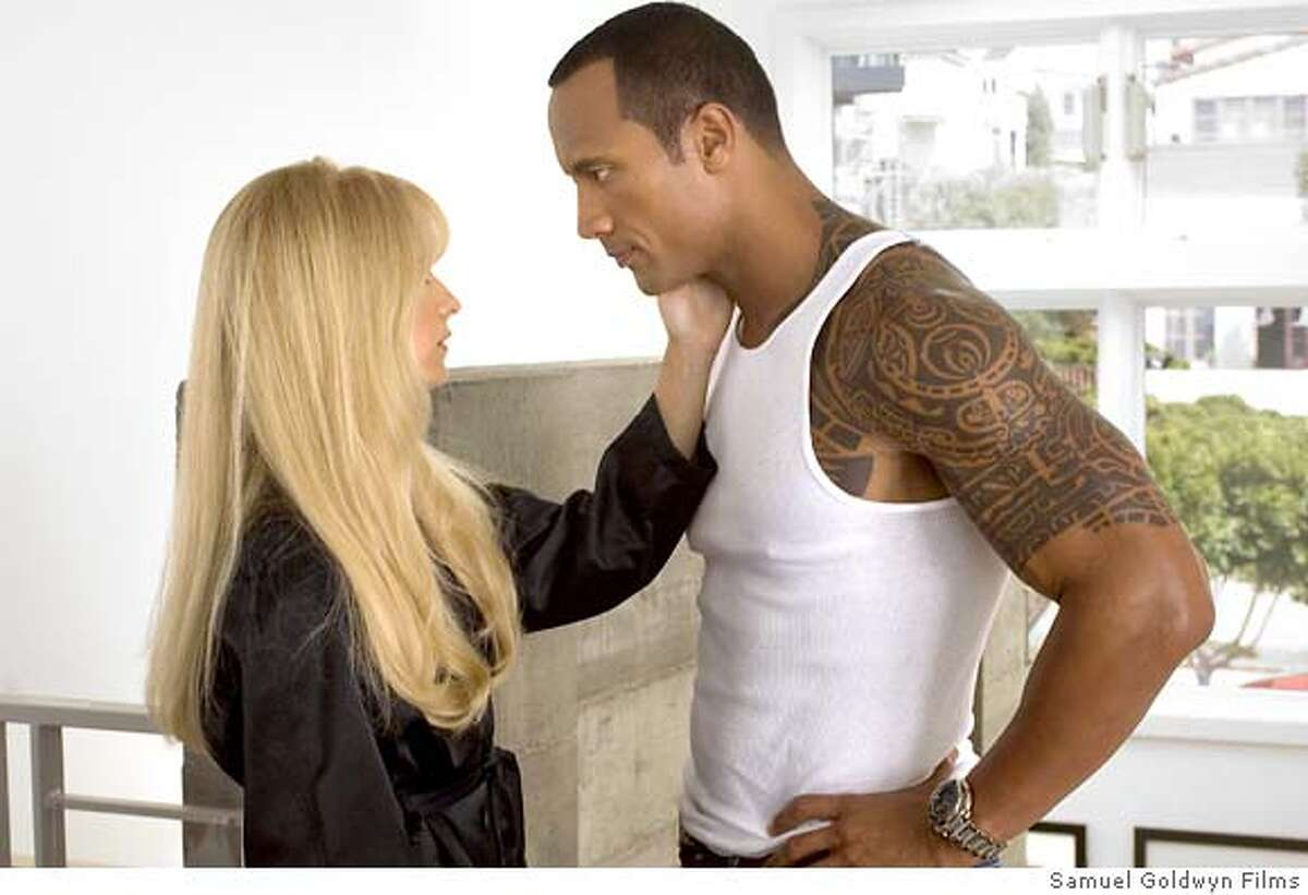 This photo provided by Samuel Goldwyn Films shows Sarah Michelle Gellar, left, and Dwayne Johnson during a scene from