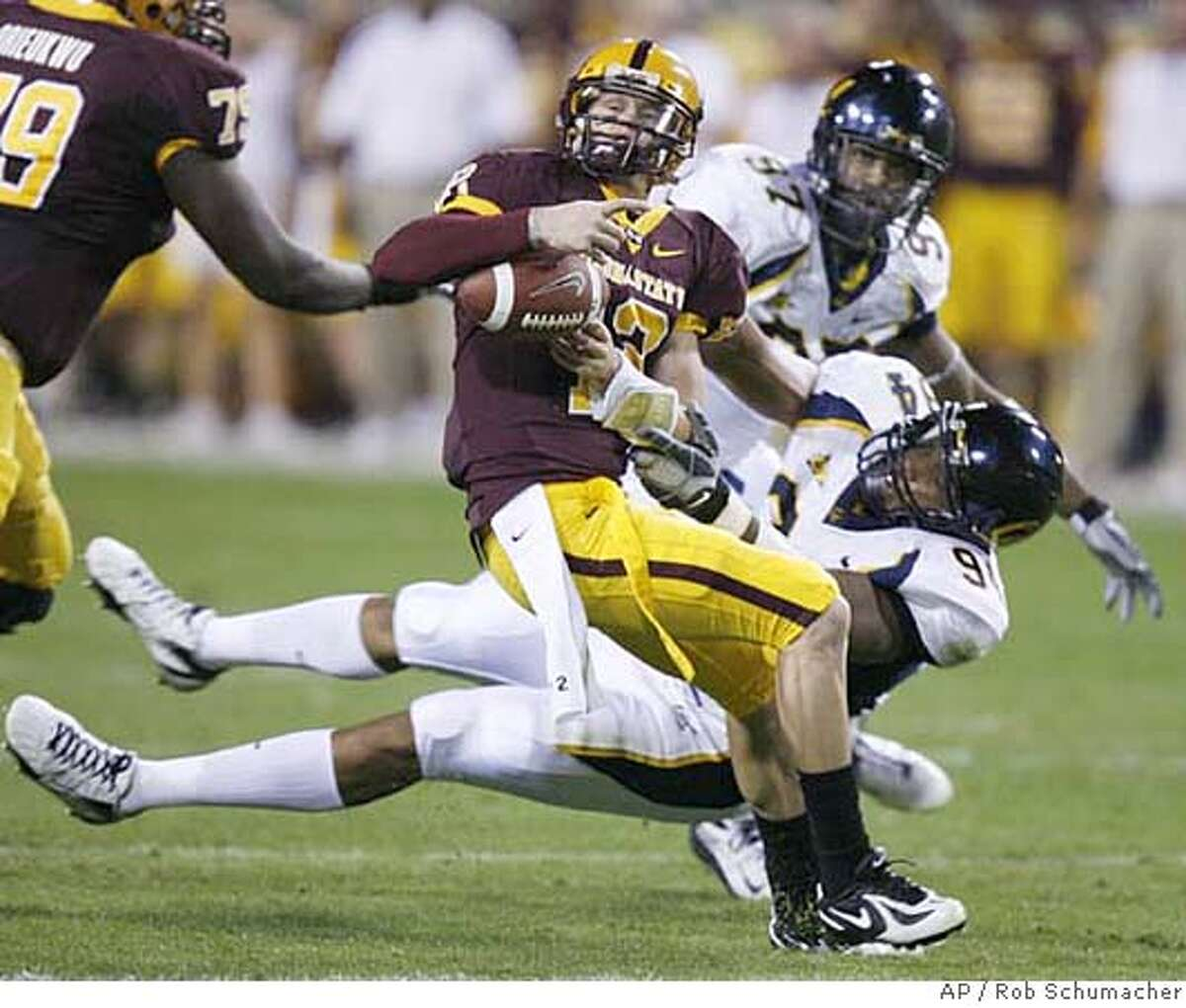 California's Rulon Davis (94) forces Arizona State quarterback Rudy Carpenter to fumble the ball during the first quarter of a college football game at Sun Devil Staduim Saturday, Oct. 27, 2007, in Tempe, Ariz.. Cal's Cameron Jordan (97) returned the fumble for a touchdown. (AP Photo/The Arizona Republic, Rob Schumacher)