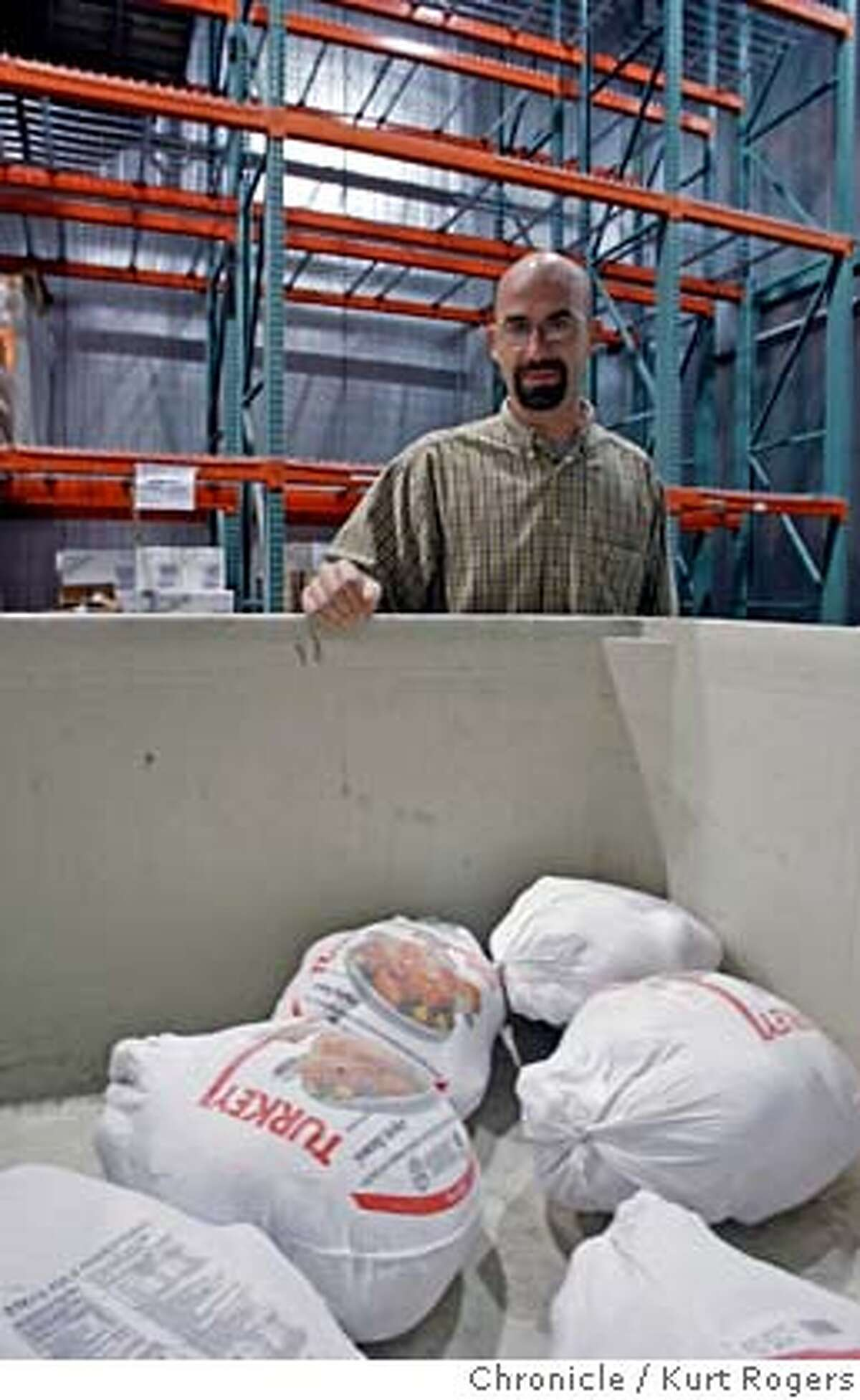 John Curry who is the resource manager at the San Francisco Food bank where they are short Turkeys for this Thanksgiving. John in side the freezer at the food bank looks into a been that would be full, also the shelves behind him are empty they would have Turkeys on them this time of year. TURKEYS15_0031_KR.jpg Kurt Rogers / The Chronicle Photo taken on 11/14/07, in San Francisco, CA, USA MANDATORY CREDIT FOR PHOTOG AND SAN FRANCISCO CHRONICLE/NO SALES-MAGS OUT