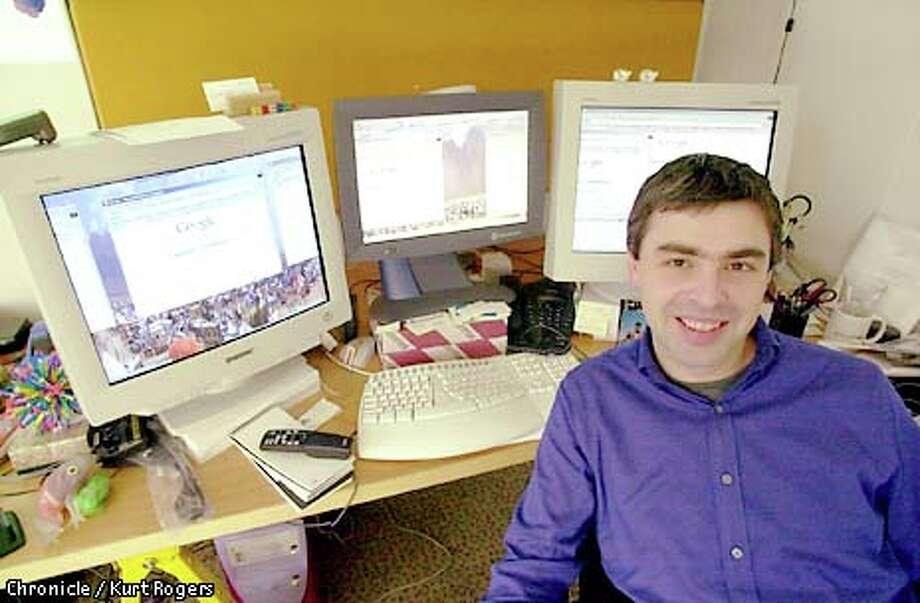 Larry Page, chief executive of Google, uses three monitors for his computer. Chronicle photo by Kurt Rogers / CHRONICLE
