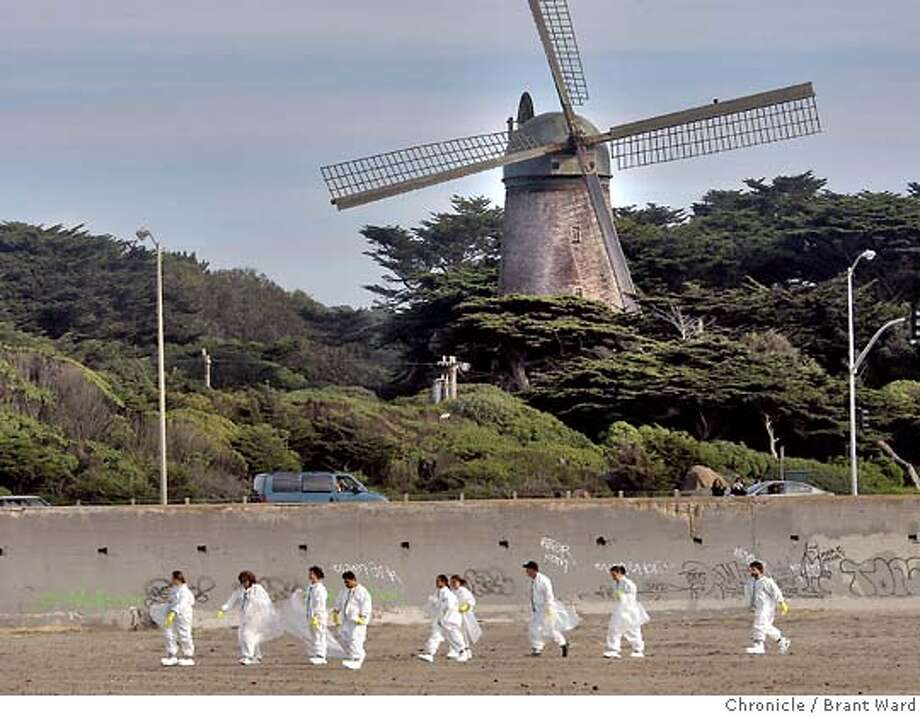 oilspill_588.JPG  A group of volunteers walked past the Golden Gate park windmill on their way down Ocean Beach.  The fight against the oil spill of 2007 began early in the day with a tour of East Beach near Crissy Field by Speaker of the House Nancy Pelosi. Also almost 200 volunteers attended a lecture about cleaning up oil spills held at the Irish Cultural Center. They would later go to Ocean Beach. {By Brant Ward/San Francisco Chronicle}11/12/07 Photo: Brant Ward
