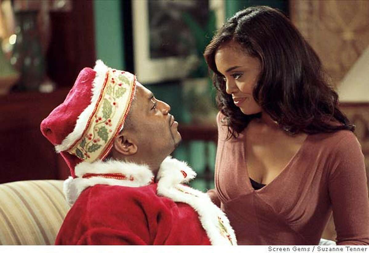 PK-13: (l-r) MEKHI PHIFER as Gerald and SHARON LEAL as Kelli Whitfield star in Screen Gems� THIS CHRISTMAS. Ran on: 11-21-2007 Mekhi Phifer and Sharon Leal in This Christmas.
