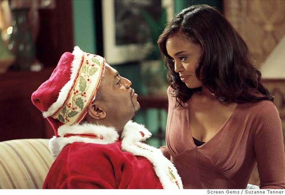PK-13: (l-r) MEKHI PHIFER as Gerald and SHARON LEAL as Kelli Whitfield star in Screen Gems� THIS CHRISTMAS.  Ran on: 11-21-2007  Mekhi Phifer and Sharon Leal in &quo;This Christmas.&quo; Photo: Suzanne Tenner