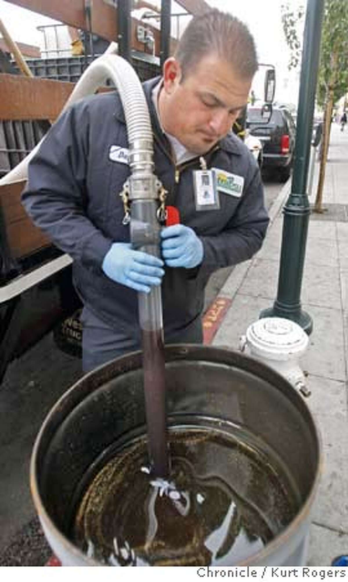 David Silvestri (cq) pumps out a fifty gallon drum of used oil taken out of the kitchen at Olivia's as restaurant on 3rd street to be recycled into biodiesel. San Francisco has a new program to recycle restaurant grease and oil and turn it into biodiesel for city vehicles. GREASECYCLE20_0122_KR.jpg Kurt Rogers / The Chronicle Photo taken on 11/16/07, in San Francisco, CA, USA MANDATORY CREDIT FOR PHOTOG AND SAN FRANCISCO CHRONICLE/NO SALES-MAGS OUT