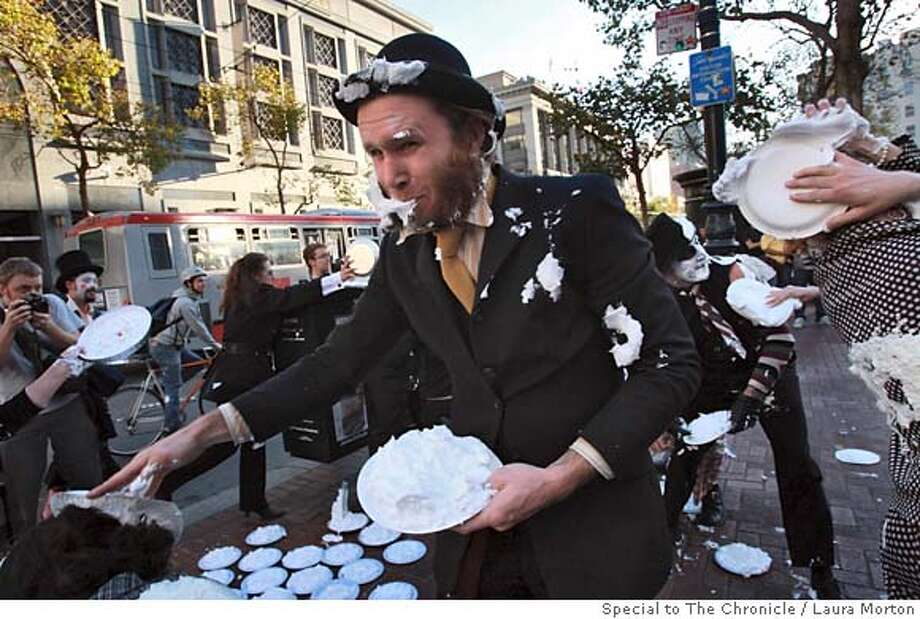 FLASHMOB_0137_LKM.jpg Ben Burke (center) participates in a flash mob pie fight at the Powell St. cable car turnaround on Friday night. The event was publicized on laughingsquid.com, a local culture blog. Flash mobs, which occur when large groups of people get together in a public place, perform an unusual action and then disperse, are becoming very regular in San Francisco. (Laura Morton/Special to the Chronicle) *** Ben Burke Photo: Laura Morton
