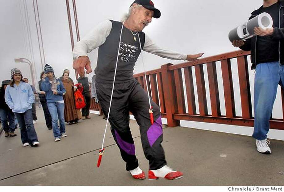 tap_601.JPG  Michael Grbich semed to enjoy his long dance...he even brought his own music and jump rope.  Oakland resident Michael Grbich celebrated his 75th birthday Sunday by tap dancing across the Golden Gate Bridge. He recently took up dancing, and was joined by relatives and friends as he danced his way across the foggy span. {By Brant Ward/San Francisco Chronicle}11/18/07 Photo: Brant Ward