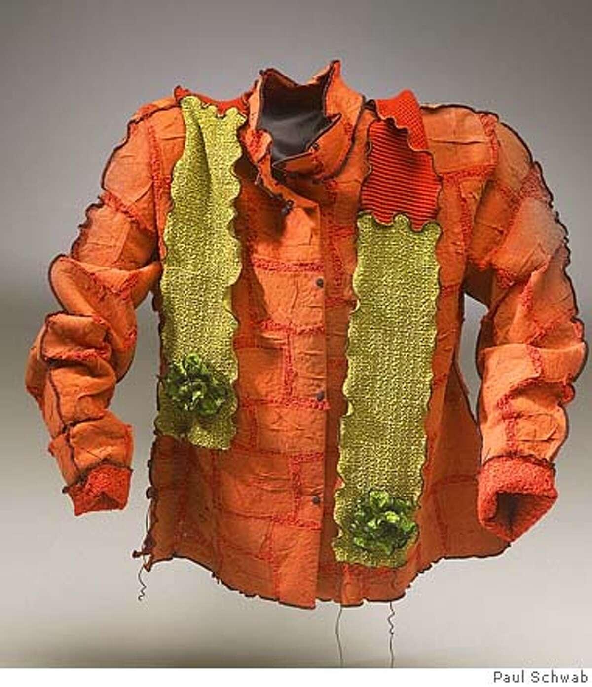 Slug: Stylematters18. I Silk shirt and silk scarf. Shirt = $425 Scarf = $105, by Deborah Cross. Photographer: Paul Schwab. Courtesy: Artwear in the Galleries. Ran on: 11-18-2007 Erin Fetherston ivory dress, $44.99, and heart bag, $29.99.