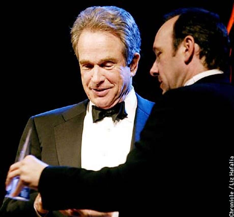 Warren Beatty and Kevin Spacey compare trophies at the film society awards at Argent Hotel.  (PHOTOGRAPHED BY LIZ HAFALIA/THE SAN FRANCISCO CHRONICLE) Photo: LIZ HAFALIA