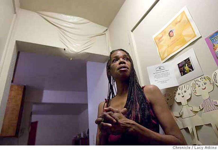 Mechela Jones shows where the sewage from the pipes in the upstairs apartment came through the ceiling of her niece, Dezyre's family apartment, Tuesday Nov. 13, 2007, in the Huntersview Projects of San Francisco, Ca. Photographer: Lacy Atkins /San Francisco Chronicle  Photo taken on 11/13/07, in san francisco, CA, USA MANDATORY CREDIT FOR PHOTOG AND SAN FRANCISCO CHRONICLE/NO SALES-MAGS OUT Photo: Lacy Atkins