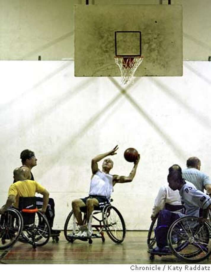 DISABLED04  Marc Geritz grabs a rebound and attempts another basket. The BORP Allstars practicing wheelchair basketball. These men are part of a group of disability rights activists in Berkeley who are fighting to get federal legislation mandating a TITLE IX for disabled people. If it happens, all publicly-funded schools and universities in the US must offer a full range of sports teams for disabled athletes. These pictures were made on Thursday Nov. 1, 2007, in Berkeley, CA.  KATY RADDATZ/The Chronicle Photo taken on 11/1/07, in Berkeley, CA, USA Photo: KATY RADDATZ