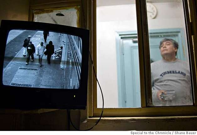 A surveillance camera looks out into the street in front of a Tenderloin single room occupancy hotel. BY SHANE BAUER/SPECIAL TO THE CHRONICLE  ONE-TIME USE ONLY  FOR RE-PUBLICATION YOU MUST CONTACT THE PHOTOGRAPHER TO ARRANGE PAYMENT BEFORE USING.  510.261.4843  shane@sharebauer.net Photo: Shane Bauer