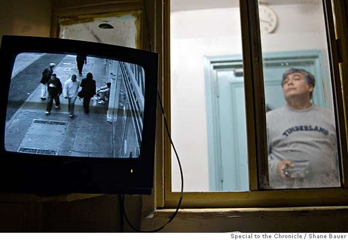 A surveillance camera looks out into the street in front of a Tenderloin single room occupancy hotel. BY SHANE BAUER/SPECIAL TO THE CHRONICLE ONE-TIME USE ONLY FOR RE-PUBLICATION YOU MUST CONTACT THE PHOTOGRAPHER TO ARRANGE PAYMENT BEFORE USING. 510.261.4843 shane@sharebauer.net