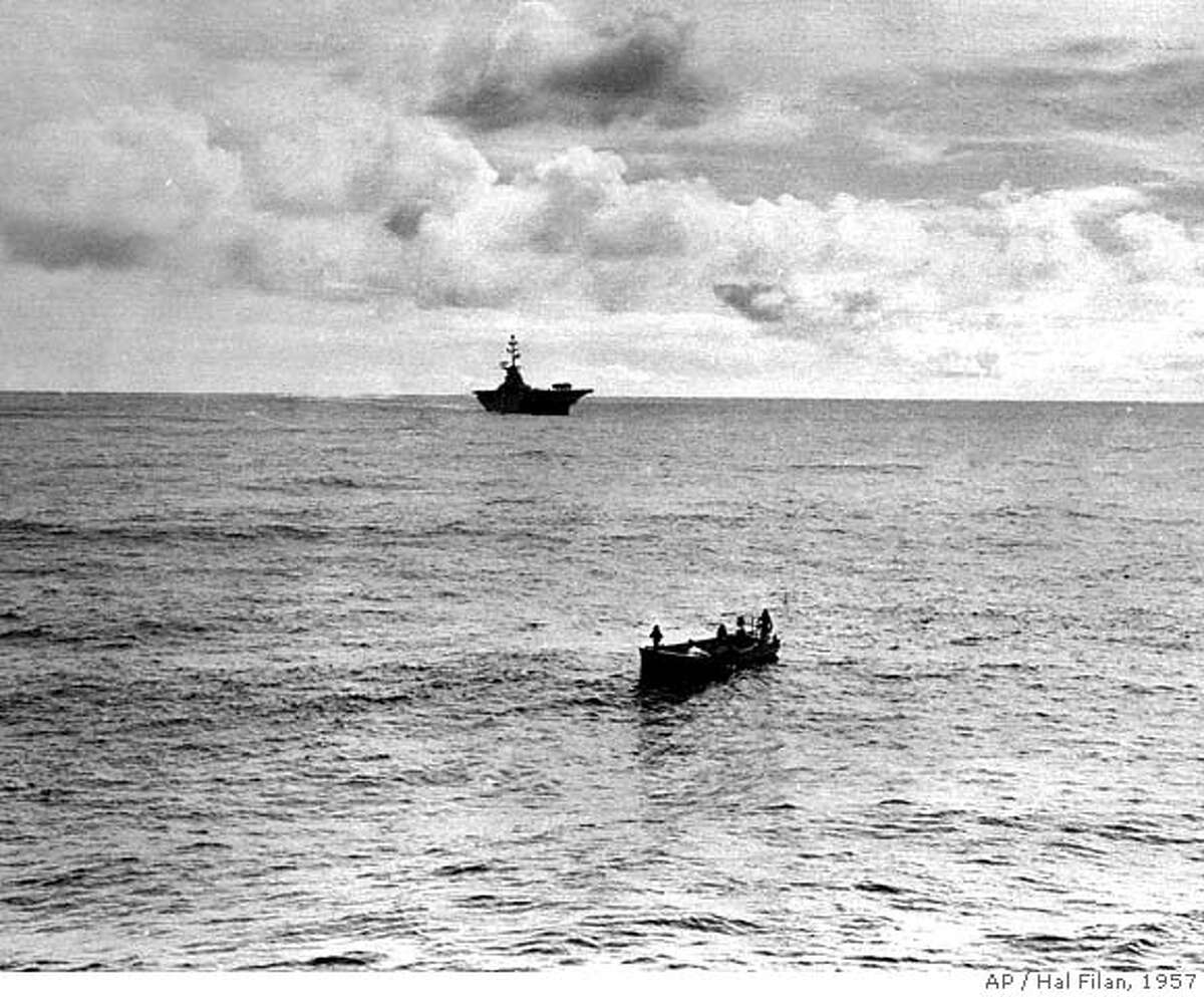An aircraft carrier moves closer to the crash site of Pan Am's Clipper Romance of the Skies in 1957. Hal Filan / Associated Press MANDATORY CREDIT FOR PHOTOG AND SAN FRANCISCO CHRONICLE/NO SALES-MAGS OUT