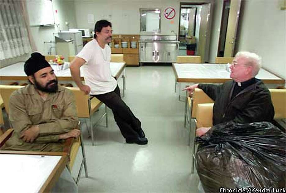 In the ship's dining room, P.S. Bhatti and Max Theodore chatted with Father Paul Devine. Chronicle photo by Kendra Luck