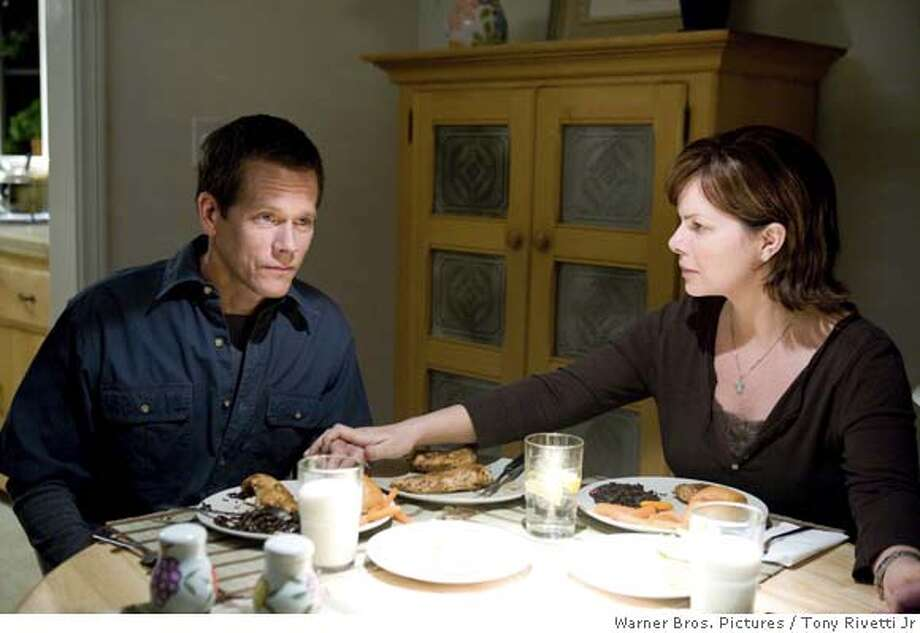 "This photo provided by Warner Brothers Pictures shows Kevin Bacon, left, and Marcia Gay Harden during a scene from ""Rails & Ties."" (AP Photo/Warner Brothers Pictures)  Ran on: 11-09-2007  Kevin Bacon and Marcia Harden play a married couple in Alison Eastwood's directing debut, &quo;Rails & Ties.&quo; Photo: Tony Rivetti Jr"