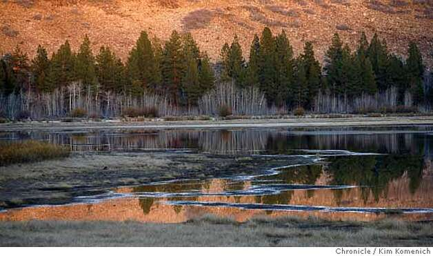 "MARTISVALLEY02_244_KK.JPG  Dry Lake glows in the last light Wednesday. Dry Lake is part of the nearly pristine Sierra Nevada landscape near Truckee known as the Martis Valley, which opens to the public for the first time in nearly four decades, thanks to a $23.5 million deal to preserve the 1,462-acre Waddle Ranch. The ranch's ""no trespassing"" signs will be removed from trails leading to the lush valley, complete with grazing bears and other wildlife, will be open to the public  Photo by Kim Komenich/The Chronicle  ** Photo: Kim Komenich"