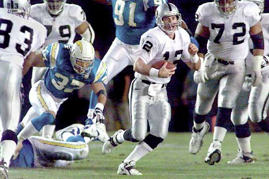 On a first-quarter play, quarterback Rich Gannon scampered away from San Diego pressure.