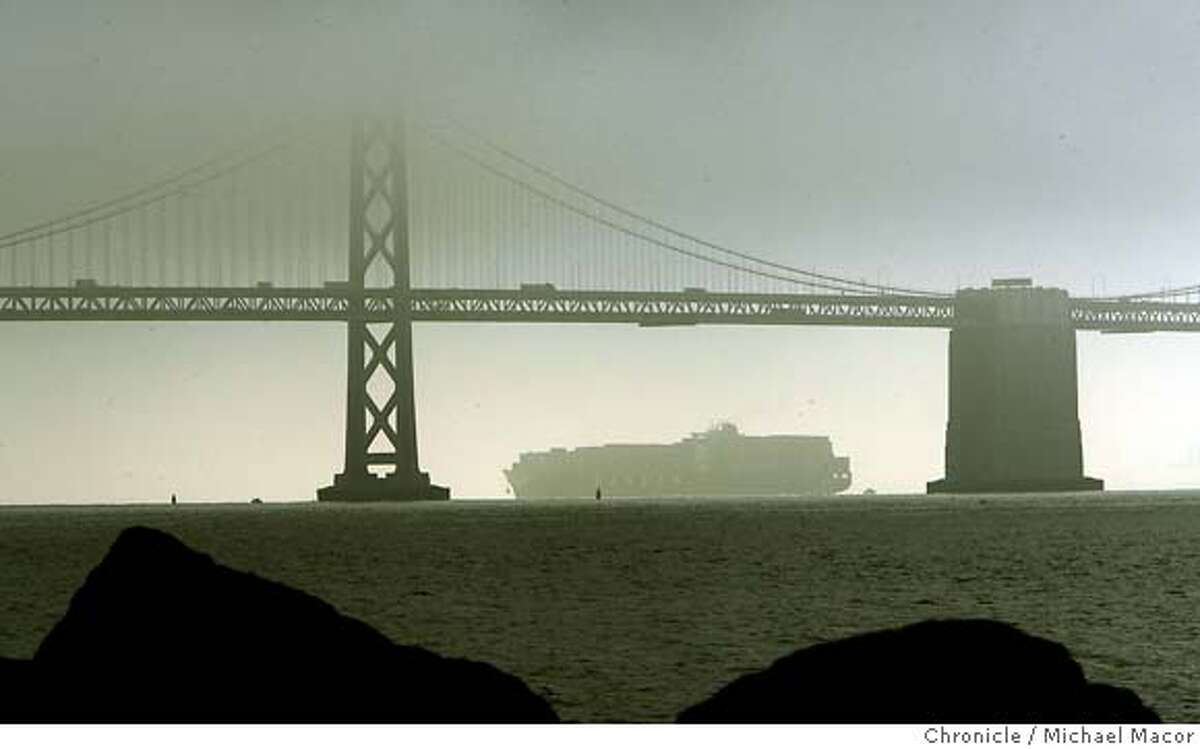 bridgehit_0137_mac.jpg The ship crosses under a fog covered Bay Bridge next to the very same tower that it struck on it's way out of the Bay. (tower on it's left). The Hanjin container ship, Cosco Busan. A large section of the shipwas damage when it came in contact a bridge tower leaving a scare on the hull about 150 feet long. Michael Macor / The Chronicle Photo taken on 11/7/07, in San Francisco, GA, USA