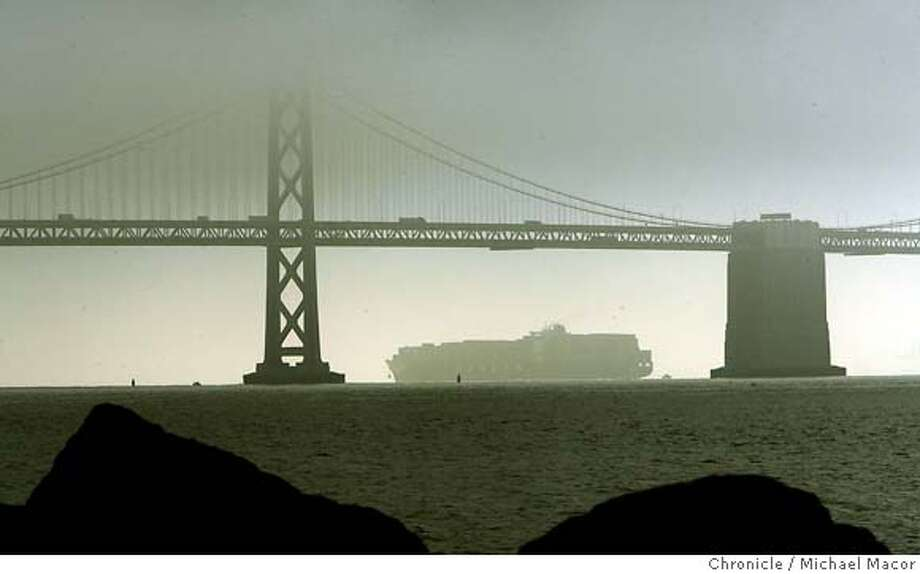 bridgehit_0137_mac.jpg The ship crosses under a fog covered Bay Bridge next to the very same tower that it struck on it's way out of the Bay. (tower on it's left). The Hanjin container ship, Cosco Busan. A large section of the shipwas damage when it came in contact a bridge tower leaving a scare on the hull about 150 feet long. Michael Macor / The Chronicle Photo taken on 11/7/07, in San Francisco, GA, USA Photo: Michael Macor