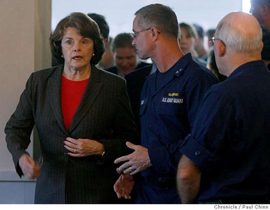 U.S. Senator Dianne Feinstein was briefed on the progress of the oil spill clean-up efforts by Coast Guard Rear Admiral Craig Bone (center) at the unified command center on Treasure Island in San Francisco, Calif. on Sunday, Nov. 11, 2007. earlier in the week Feinstein harshly criticized the apparent slow response by the Coast Guard to the accident but she backed off those remarks at a news conference.  PAUL CHINN/The Chronicle  **Dianne Feinstein, Craig Bone Photo: PAUL CHINN