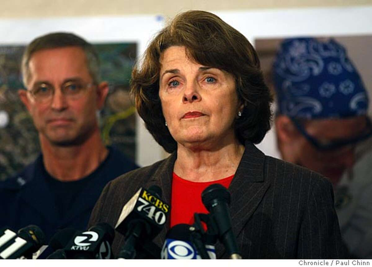 U.S. Senator Dianne Feinstein speaks at a news conference after she was briefed on the progress of the oil spill clean-up efforts by Coast Guard Rear Admiral Craig Bone (left) and other officials at the unified command center on Treasure Island in San Francisco, Calif. on Sunday, Nov. 11, 2007. earlier in the week Feinstein harshly criticized the apparent slow response by the Coast Guard to the accident but she backed off those remarks at a news conference. PAUL CHINN/The Chronicle **Dianne Feinstein, Craig Bone