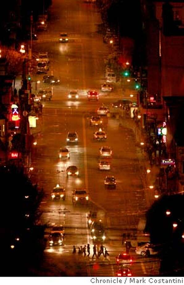 Castro Street on Halloween night at about 730 p.m. . Even the Castro Theater (right) sign is dark. Mark Costantini / The Chronicle Photo taken on 10/31/07, in San Francisco, CA, USA Photo: Mark Costantini