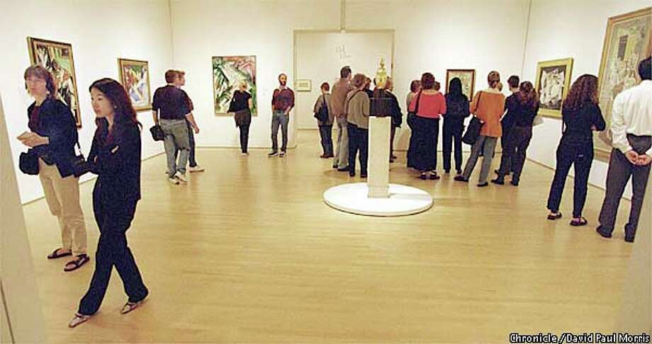 SFMOMA visitors pack galleries on the first Tuesday of the month to take advantage of the free admission day. Chronicle photo by David Paul Morris