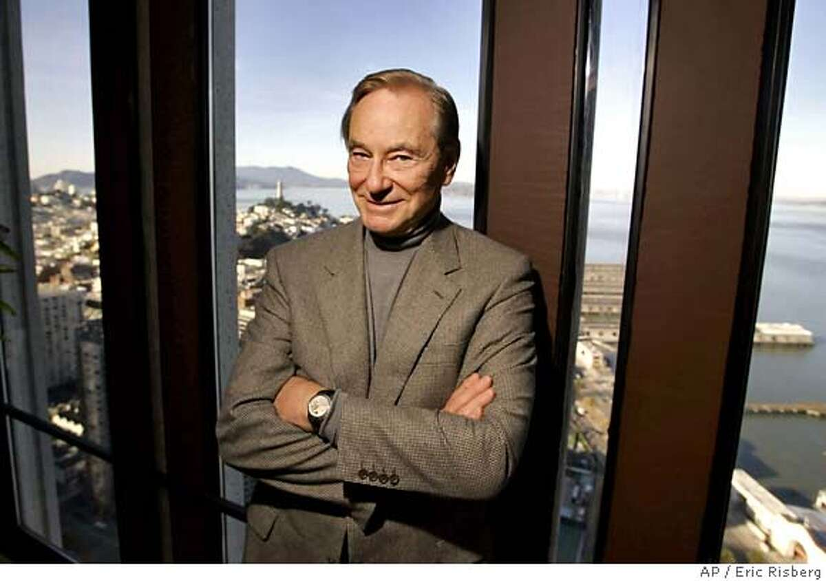 """Tom Perkins, 73, author of the novel, """"Sex and the Single Zillionaire,"""" poses in his office in San Francisco, Monday Jan. 23, 2006. In the background is Telegraph Hill and San Francisco Bay. (AP Photo/Eric Risberg)"""