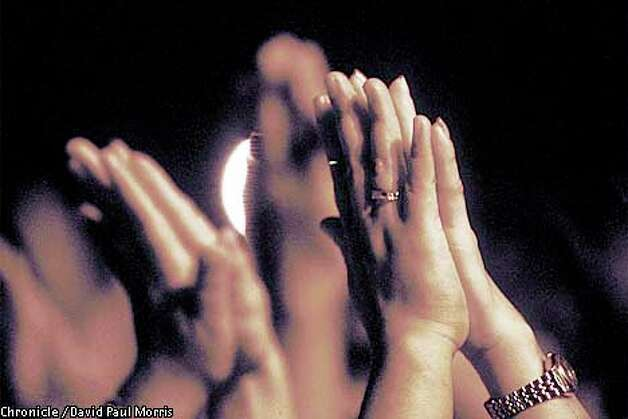Hands came together in prayer at a recent El Shaddai rally in Manila.  Photo by David Paul Morris special to the Chronicle.