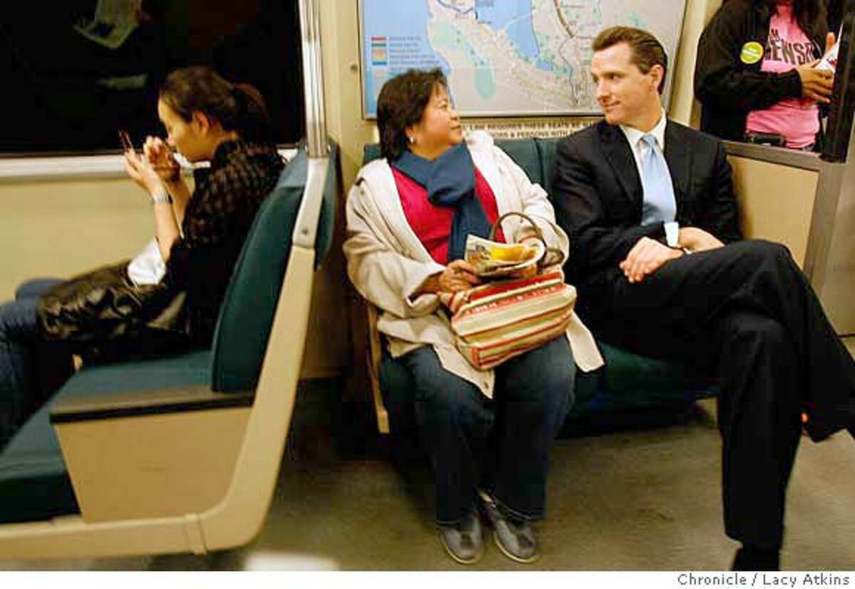 Virgina DeCicco is surprises as Mayor Gavin Newsom sits down next to her on the BART train while campaigning, Tuesday Nov.6, 2007, in San Francisco, Ca. Photographer: Lacy Atkins /San Francisco Chronicle Photo taken on 11/5/07, in SAN FRANCISCO , CA, USA MANDATORY CREDIT FOR PHOTOG AND SAN FRANCISCO CHRONICLE/NO SALES-MAGS OUT