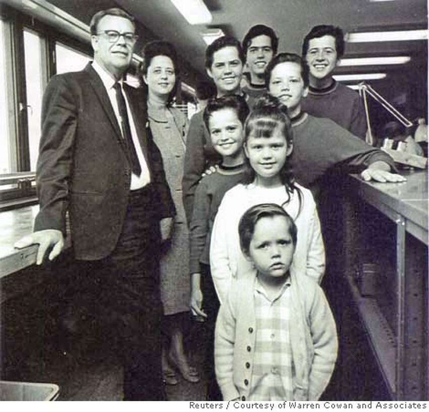 George (L) and Olive Osmond are pictured with the Osmond children in this undated photograph. The other members of the Osmond family are (from top L-R): Alan, Wayne, Merrill and Jay Osmond, and (C, front to back) Jimmy, Marie and Donny.