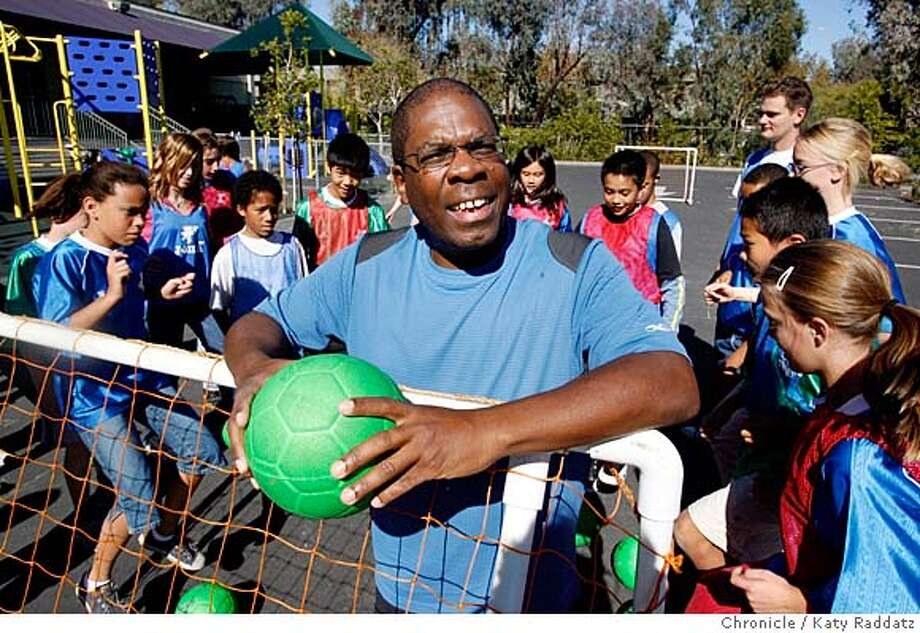 JA_EWELL  Jefferson Award profile of Russell Ewell, who is a driving force behind the creation and continual develoment of a community soccer program for kids with special needs. The Hope Technology School soccer players can be seen working out behind Russell Ewell. These pictures were made on Monday Oct. 22, 2007, in Palo Alto, CA.  KATY RADDATZ/The Chronicle Photo taken on 10/22/07, in Palo Alto, CA, USA Photo: KATY RADDATZ