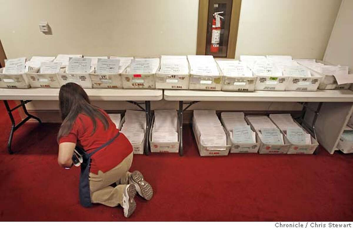 San Francisco election clerk Joyce Geronimo (cq) arranges absentee ballots in trays in the Department of Election office at City Hall. Photographed November 6, 2007. Chris Stewart / The Chronicle Photo taken on 11/6/07, in San Francisco, CA, USA Joyce Geronimo, absentee ballots, election, San Francisco